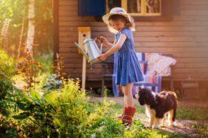 Kind Und Hund Beim Gärtnern